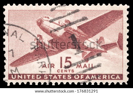 USA-CIRCA 1941: A 15 cent United States Airmail postage stamp shows image of a twin-engined transport plane, circa 1941. - stock photo