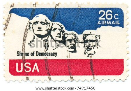 USA - CIRCA 1974: A post stamp printed in USA shows stone sculptures of George Washington, Thomas Jefferson, Theodore Roosevelt, and Abraham Lincoln, circa 1974 - stock photo
