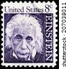 USA - CIRCA 1966: A postage stamp printed by USA shows image portrait of famous American physicist Albert Einstein, who developed the theory of general relativity, circa 1966. - stock photo