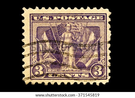 USA-CIRCA 2016: A stamp printed in the United States in 1919 shows image of Lady Liberty with flags of the world war 1 allies victory issue, circa 2016.