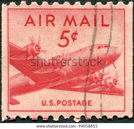 USA - CIRCA 1948: A stamp printed in the USA, shown Military transport aircraft Douglas C-54 (DC-4) Skymaster, circa 1948 - stock photo