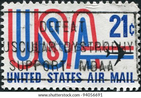 USA - CIRCA 1971: A stamp printed in the USA, shows an inscription USA and jet aircraft, circa 1971 - stock photo