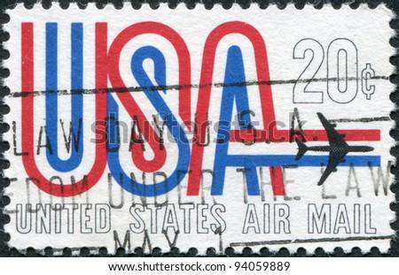 USA - CIRCA 1968: A stamp printed in the USA, shows an inscription USA and jet aircraft, circa 1968 - stock photo