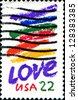 "USA - CIRCA 1985: A stamp printed in the USA, shows colored lines and text ""Love"", circa 1985 - stock photo"
