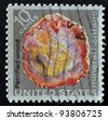 USA - CIRCA 1974: A stamp printed in the USA shows petrified wood, mineral heritage, circa 1974 - stock photo