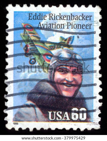 "USA - CIRCA 1995: A stamp printed in the USA shows plane and pilot with inscription ""Eddie Rickenbaker Aviation Pioneer"" .Circa 1995 - stock photo"