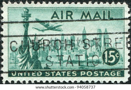 USA - CIRCA 1947: A stamp printed in the USA, shows the Statue of Liberty and New York Skyline, airliner Lockheed Constellation, circa 1947 - stock photo