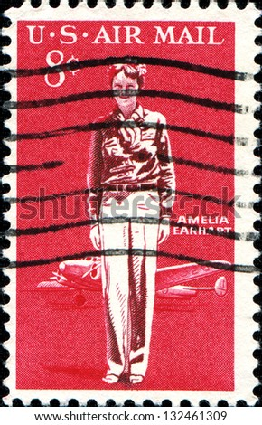 USA - CIRCA 1963: A stamp printed in United States of America shows Amelia Earhart and  Lockheed Electra, circa 1963 - stock photo
