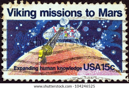 USA - CIRCA 1978: A stamp printed in USA issued for the 2nd anniversary of Viking 1 landing on Mars shows Viking 1 lander scooping soil from Mars, circa 1978. - stock photo