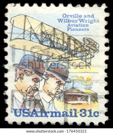 USA - CIRCA 1978: A stamp printed in USA issued for the 75th Anniversary of First Powered Flight shows Wright brothers and Wright Flyer I plane, circa 1978. - stock photo