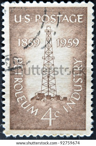 USA - CIRCA 1959 : A stamp printed in USA show Petroleum Industry with first oil well at Titusville, Pennsylvania, circa 1959 - stock photo