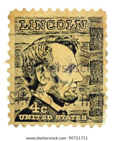 USA - CIRCA 1965: A stamp printed in USA shows a picture of Abraham Lincoln against a log cabin wall in the background, circa 1965