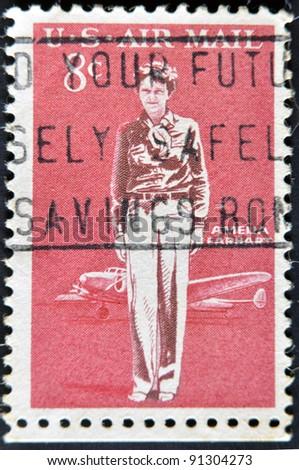 USA - CIRCA 1963: A stamp printed in USA shows Amelia Earhart, circa 1963 . - stock photo