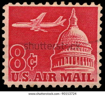 USA - CIRCA 1962: A stamp printed in USA shows an airplane flying across the Senate building, circa 1962. - stock photo
