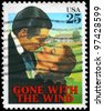 "USA - CIRCA 1990: A stamp printed in USA shows Clark Gable and Vivien Leigh (Gone with the Wind), ""Classic Films"" series, circa 1990 - stock photo"