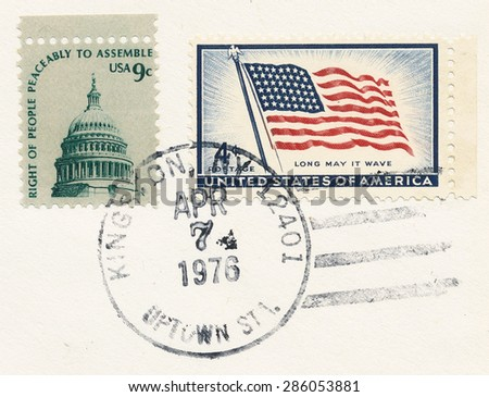 USA - CIRCA 1975: A stamp printed in USA shows Cut out of the mail envelope with two stamps, Dome of Capitol and Flag and stamp Apr. 7 1976 Kingston, circa 1975 - stock photo