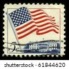 USA - CIRCA 1960: A stamp printed in USA shows image of the dedicated to the American Flag circa 1960. - stock photo