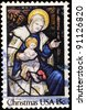 USA -CIRCA 1980: A stamp printed in USA shows the picture of Madonna and Child in her lap, circa 1980 - stock photo