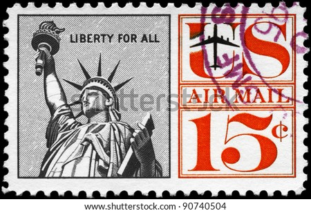 "USA - CIRCA 1959: A stamp printed in USA shows the Statue of Liberty, with the inscription ""Liberty for all"", series, circa 1959 - stock photo"