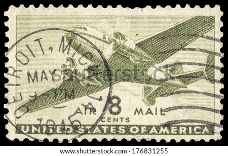 USA-CIRCA 1944: An 8 cent United States Airmail postage stamp shows image of a twin-engined transport plane, circa 1944. - stock photo