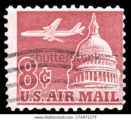 USA-CIRCA 1962: An 8 cent United States Airmail postage stamp shows image of Jetliner Over Capitol Building, circa 1962. - stock photo