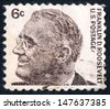 USA, CIRCA 1966: an old used postage stamp issued in honor of the 32nd President of the United States Franklin Delano Roosevelt with his portrait on white background; series, circa 1966 - stock photo