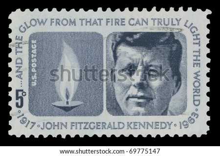 USA - CIRCA 1964 - John Fitzgerald Kennedy (1917-1963) American stamp shows the 35th United States President and the Eternal Flame, circa 1964. - stock photo