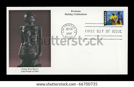 USA - CIRCA 1997-  Kwanzaa  holiday postage stamp on envelope shows an African-American family observing the celebrations with a First Day of Issue cancellation. - stock photo