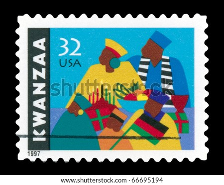 USA - CIRCA 1997-  Kwanzaa  holiday postage stamp shows an African-American family observing the celebrations .  Design by Synthia Saint James, circa 1997. - stock photo