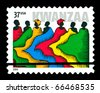 USA - CIRCA 2004-  Kwanzaa  holiday postage stamp titled People in Robes.  Design by Derry Noyes, circa 2004. - stock photo