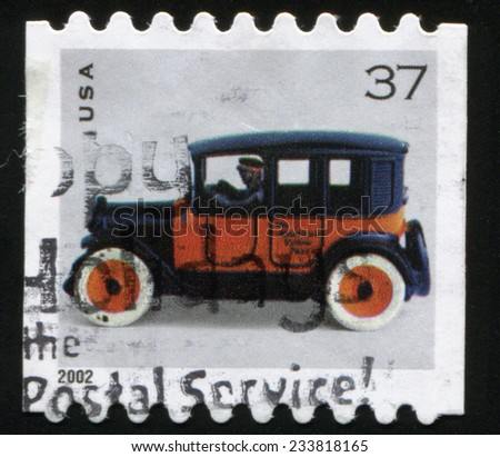 USA - CIRCA 2002: Postage stamp printed in the United States shows a Toy Taxicab. Black vehicle with orange doors and white wheels circa 2002