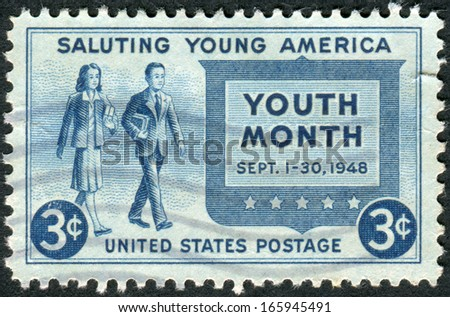 """USA - CIRCA 1948: Postage stamp printed in the USA, Salute to Youth Issue, Youth of America and """"Youth Month,"""" shows a Girl and Boy Carrying Books, circa 1948 - stock photo"""
