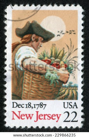 USA- CIRCA 1987: Postage stamp printed in United States of America shows a man with a basket with apples and corn Ratification of the Constitution. Scott Catalog A1702 2338 22c, circa 1987 - stock photo