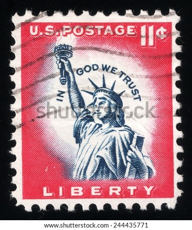 """USA - CIRCA 1961: postage stamp printed in USA shows a picture of Statue of Liberty in a close-up containing the motto: """"in god we trust"""", circa 1961 - stock photo"""