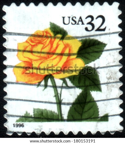 USA - CIRCA 1997: Postage stamps printed in USA, shows a blooming yellow rose, circa 1997  - stock photo