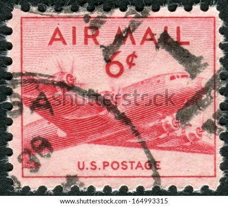 USA - CIRCA 1949: Postage stamps printed in USA, shows airplane DC-4 Skymaster, circa 1949 - stock photo