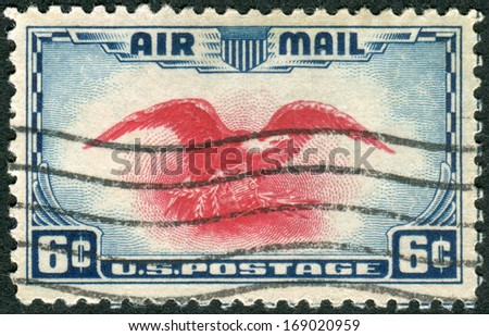 USA - CIRCA 1938: Postage stamps printed in USA, shows Eagle Holding Shield, Olive Branch and Arrows, circa 1938 - stock photo