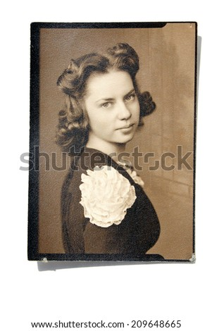 USA- CIRCA 1900s: An antique photo shows studio portrait of a young woman.  - stock photo