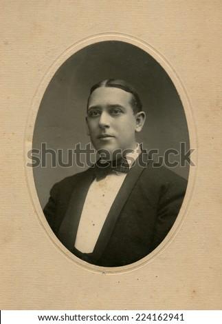 USA- CIRCA 1910s: Vintage photo shows portert of young businessman.  - stock photo