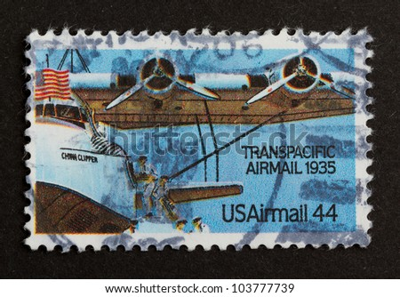 USA - CIRCA 1975: Stamp printed in the USA shows a airplane from the Transpacidic Airmail 1935, circa 1975 - stock photo