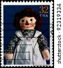 "USA - CIRCA 1997 : Stamp printed in the USA shows Johnny Gruelle's ""Raggedy Ann"" doll, circa 1997 - stock photo"