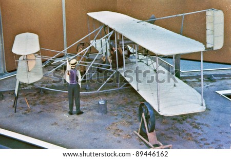 USA - CIRCA 1900 - This aged vintage postcard is showing signs of wear, depicting the era of the Wright Brothers working on the invention of flight aviation.  A defining moment in US history. - stock photo