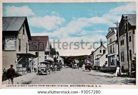 USA - CIRCA 1900 - This vintage postcard is aged and worn of Center Street near Railway Station in Wolfeboro, N.H. depicting American history in that era. circa 1900 - stock photo