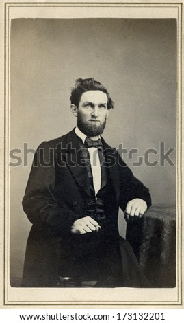 USA - CONNECTICUT - CIRCA 1865 - A vintage Cartes de visite photo of a gentleman. The man is sitting with one arm on a table. A photo from the Civil War Victorian era. CIRCA 1865 - stock photo