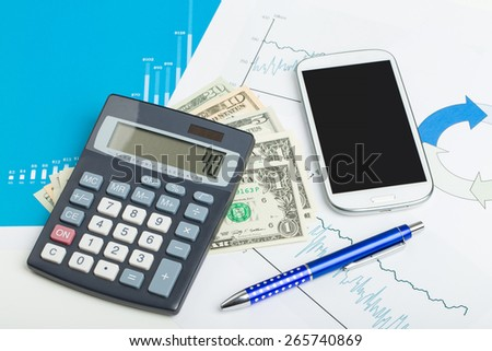 USA dollar money banknotes and calculator, money concept, business workplace with mobile phone - stock photo