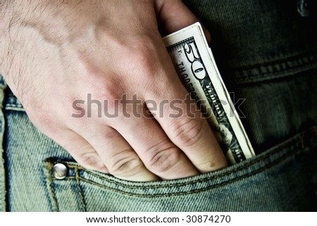 USA fifty dollars in  hip-pocket of jeans - stock photo