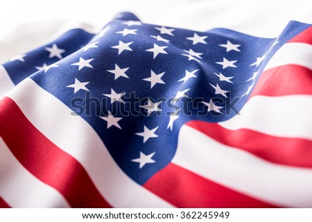 USA flag. American flag. American flag blowing wind. Close-up. Studio shot. - stock photo