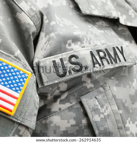 USA flag and U.S. Army patch on solder's uniform - stock photo