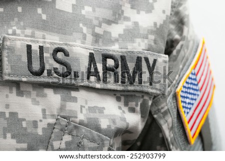 USA flag and US Army patch on solder's uniform - stock photo