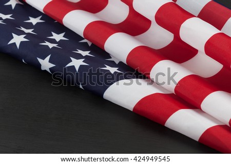 USA flag folds on black chalkboard with copy space